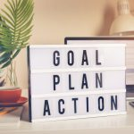 A light box that says: Goal, Plan, Action