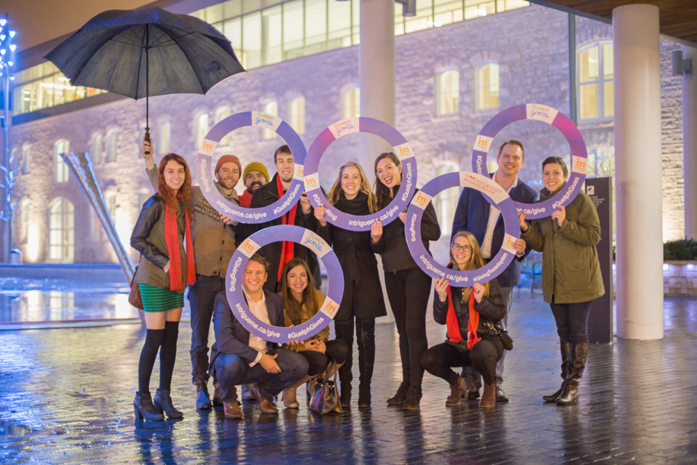 Intrigue Team with the Giving Ring outside Guelph City Hall on Giving Tuesday