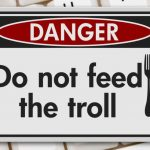 5 Ways To Handle Social Media Trolls- Danger Sign with the words Do Not Feed The Troll over a keyboard