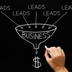How To Use The Marketing Funnel To Grow Your Business- Hand drawing Lead Generation Business Funnel concept with white chalk on blackboard.