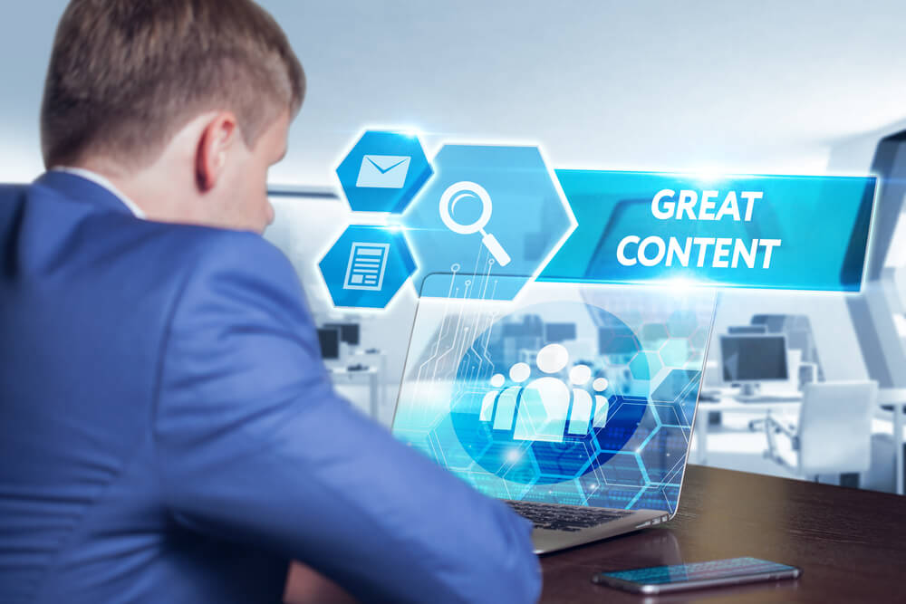 Business, technology, internet and networking concept. Young businessman working on his laptop in the office, select the icon great content on the virtual display.