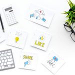 Social Media Giveaways. Work desk of marketing specialist with social media icons and symbols on white background top view copy space
