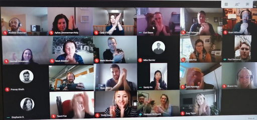 Intrigue team clapping on a video call