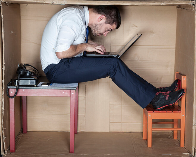 businessman who has outgrown his work station